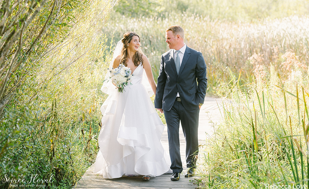 Bride and Groom Holding Hands at the Nantucket Lily Pond. Photo by Rebecca Love Photography.