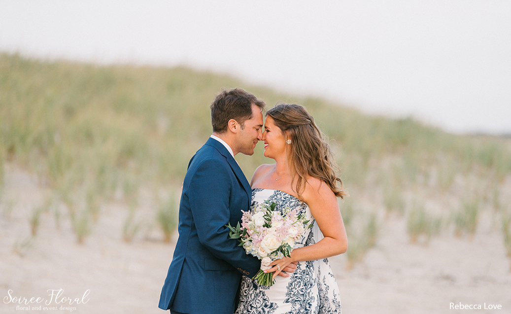 Bride and Groom with Bouquet at Fishermen's Beach. Oscar de la Renta Floral Gown.