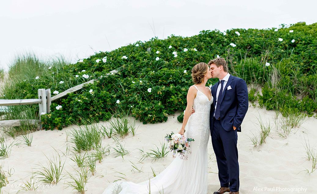 bride groom kiss beach