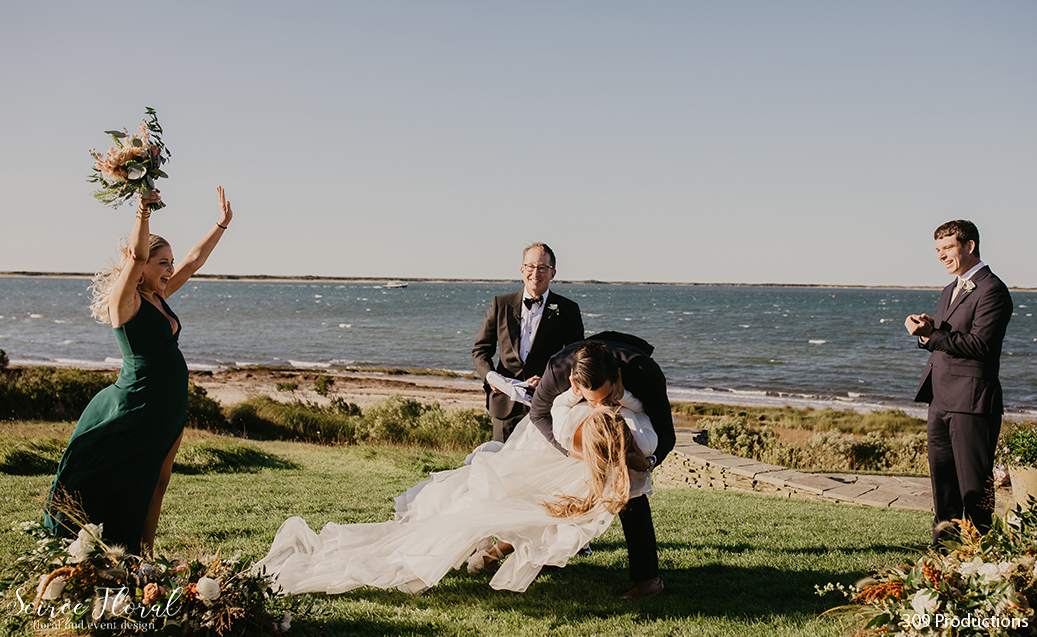 Boho Chic Micro Wedding Sweeping Bride and Groom Kiss. Bridesmaid cheering, Groomsman clapping. Photo by 309 Productions.