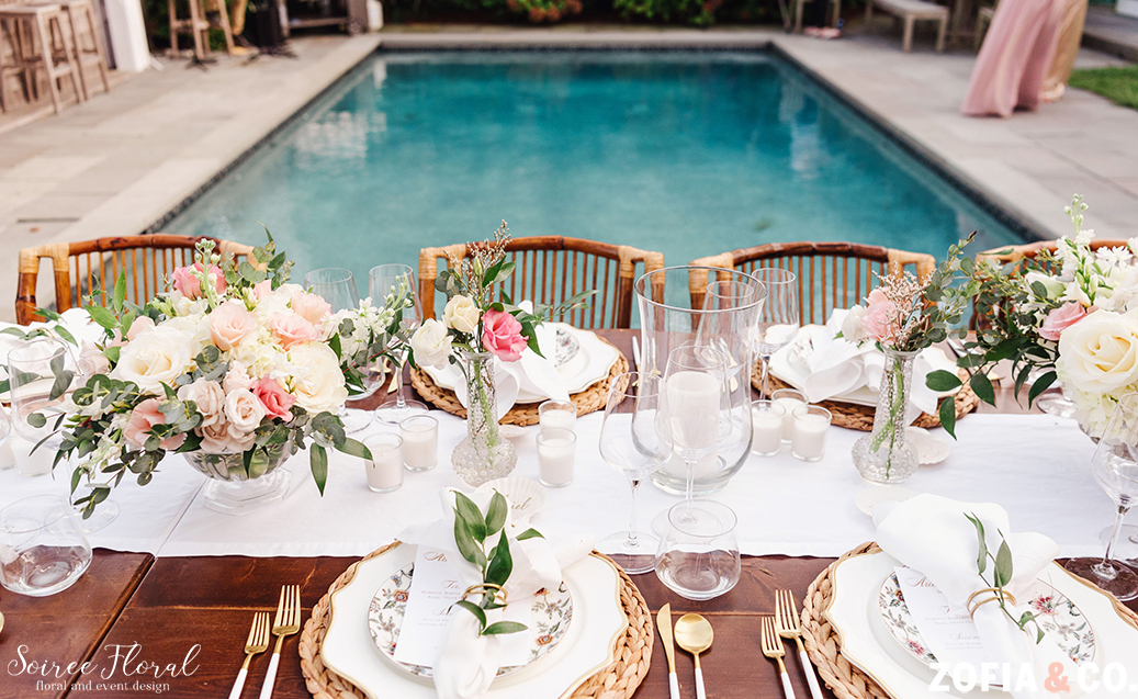Backyard micro wedding tablescape. Farm table with floral centerpieces, bud vases, votives candles and hurricane lanterns. Photo by Zofia&Co. Photography.