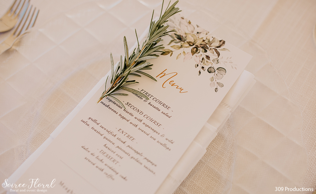 Boho Chic Wedding Menu. Linen Napkin, sprig of rosemary. Photo by 309 Productions.